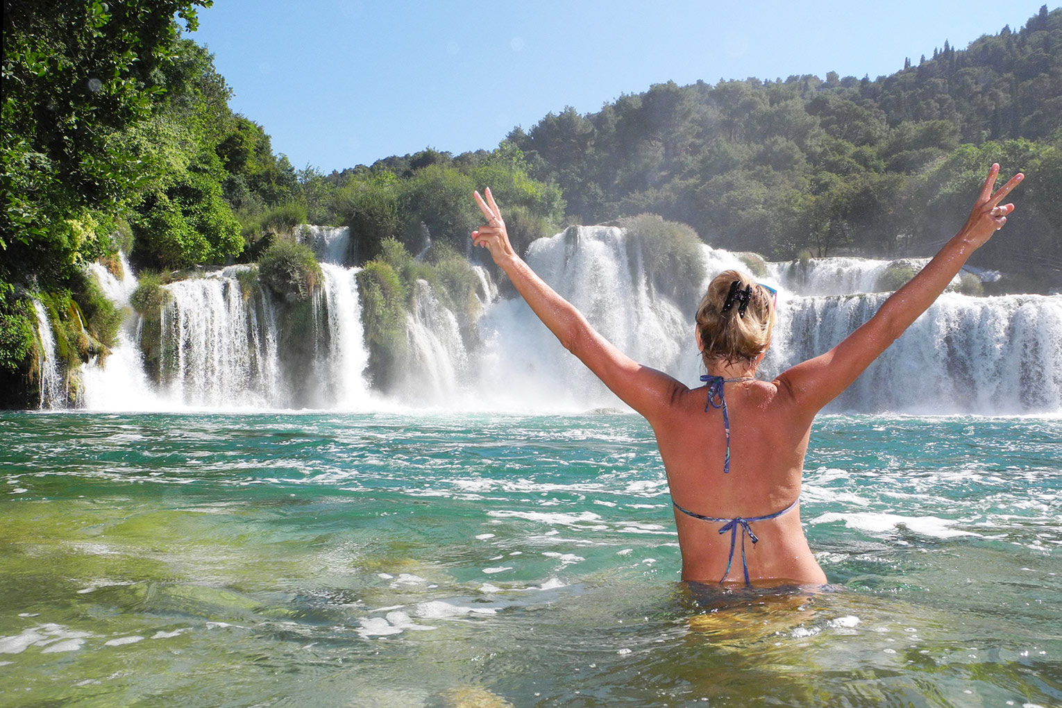 Swimming by Skradinski buk waterfall in Krka National Park
